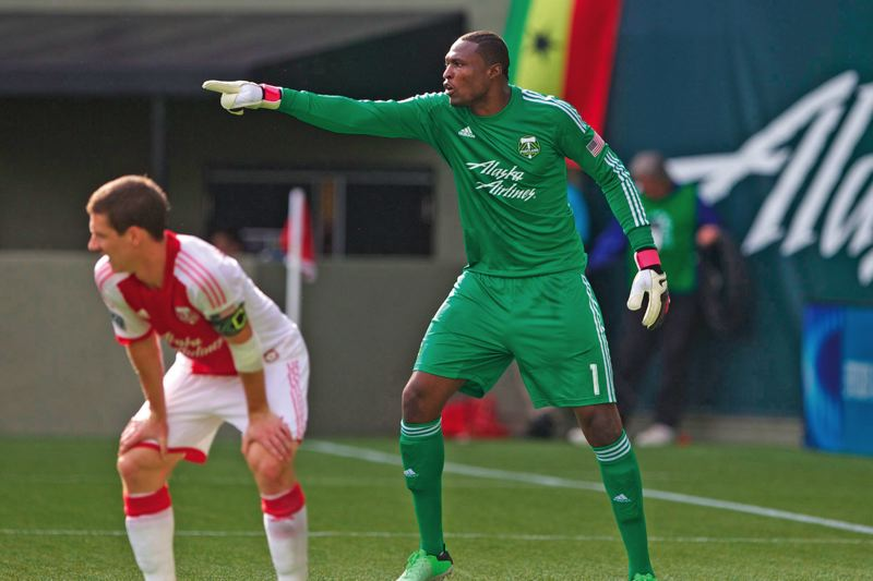 by: TRIBUNE PHOTO: JAIME VALDEZ - Donovan Ricketts, veteran goalkeeper, directs traffic for the Portland Timbers during a recent home game against the Colorado Rapids.