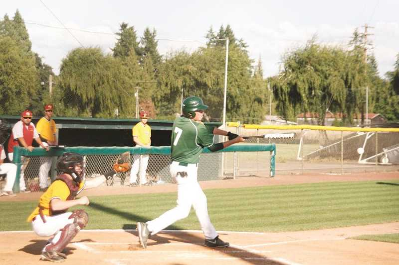 by: PHOTO BY PHIL HAWKINS - Matthew Robinson hits double to left field