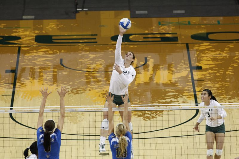 by: COURTESY PHOTO: ERIC EVANS  - University of Oregon outside hitter Liz Brenner says she wants to play pro volleyball but loves basketball, track and field and softball as well.