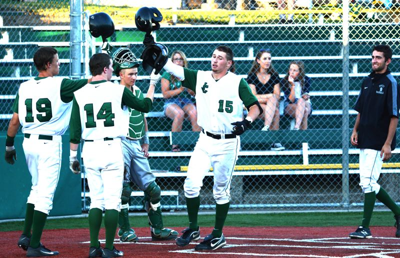 by: TIMES PHOTO: MATT SINGLEDECKER - Jesuit shortstop Trent Werner celebrates his three-run homer with Evan Haberle and Josh Anderson in the sixth inning of the Crusaders win.