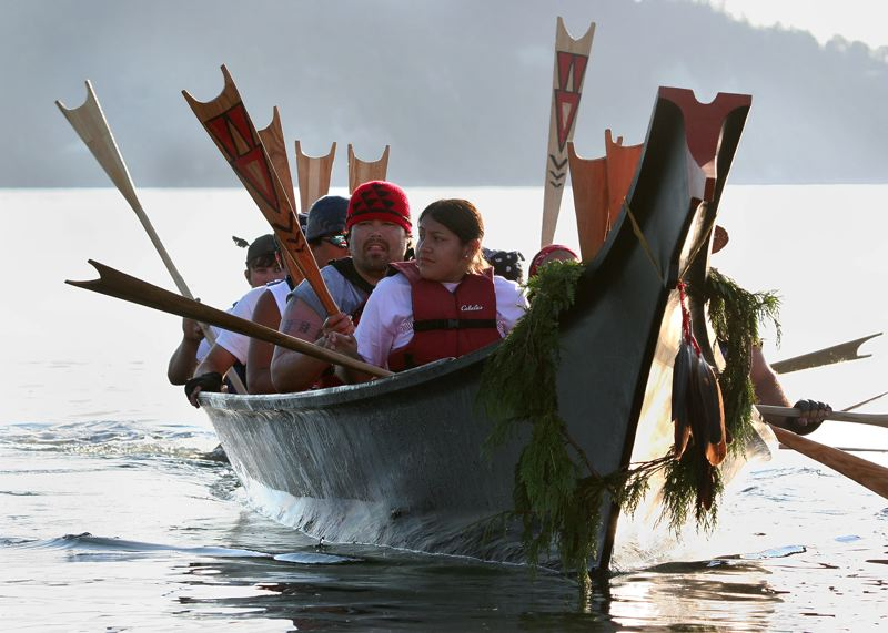 by: COURTESY OF: MICHELLE ALAIMO, SMOKE SIGNALS  - Every youth involved in Canoe Journey carves hir or her own paddle. The canoes are handmade by tribal carvers and each one is given a name and blessed before entering the water.