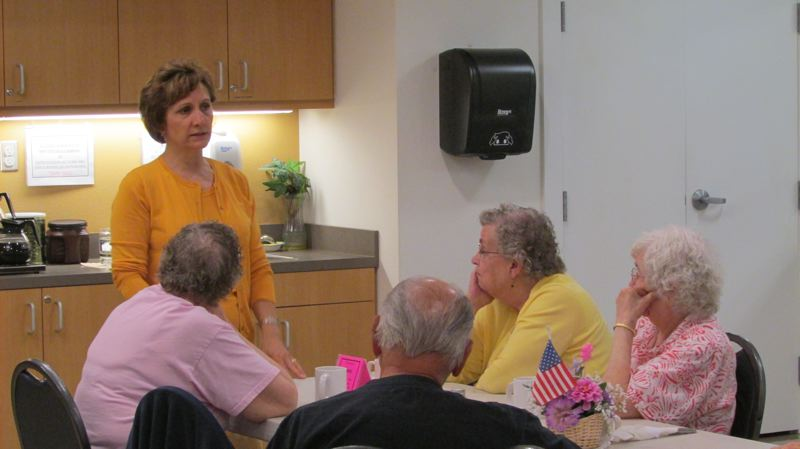 by: MARK MILLER - Rep. Suzanne Bonamici, D-Ore., speaks to senior citizens at the St. Helens Senior Center about the effects of federal spending cuts on senior programs.