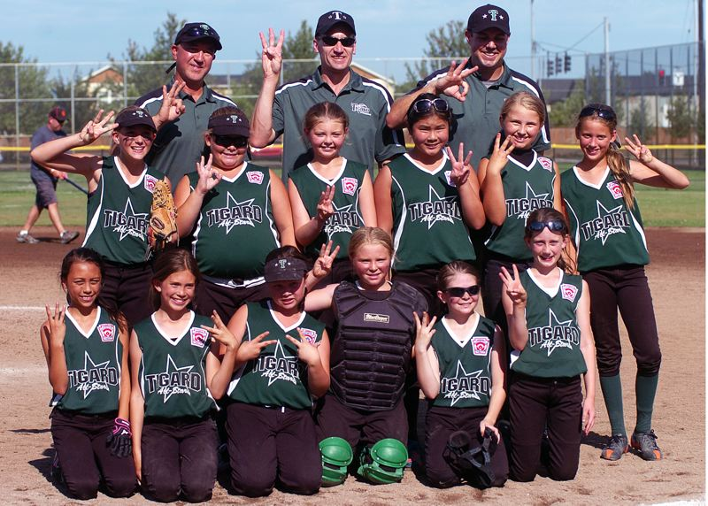 by: DAN BROOD - TERRIFIC TEAM -- The Tigard Little League all-star softball players and coaches all hold up three fingers following the team's 13-5 win over Lents in the Oregon State Tournament third-place game.