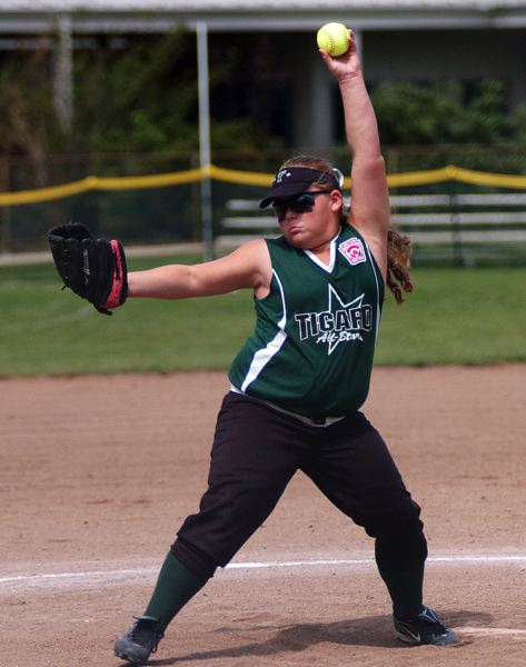 by: DAN BROOD - HERE IT COMES -- Tigard's Victoria Vanderburg gets ready to fire in a pitch during Tuesday's state tournament third-place game.