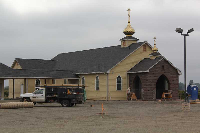 by: PHOTO BY: JEFF MCDONALD  - Construction is nearly completed on a Russian Old Believer church south of Woodburn. Plans include a 3,000 square-foot assembly hall and 6,000 meeting place, according to the Marion County Building Department.