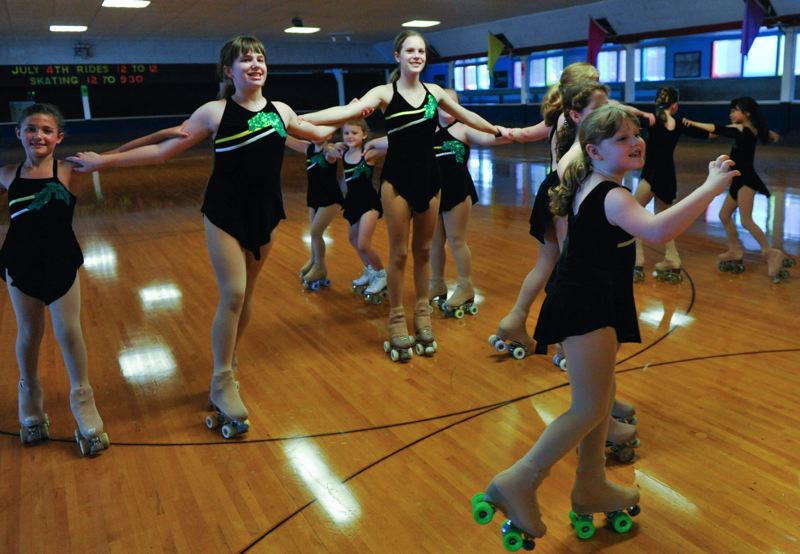 by: JOHN LARIVIERE - Oakettes skate a 4-spoke pinwheel as they gear up for the USA Roller Sports National Championships in Albuquerque, New Mexico.