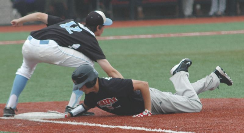 by: SANDY POST: PARKER LEE - Sandys Rhett Schilperoort dives safely back to first base during Saturdays 5-4 loss to Lakeridge