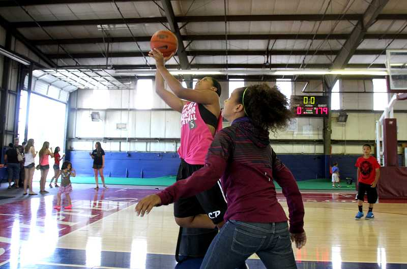 Jazzy Brown takes a shot at the hoop against her sister Gabby Brown at the new Practice Facility in Tigard.