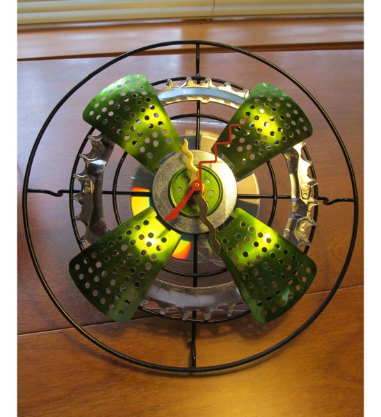by: PHOTOS BY ELLEN SPITALERI - A working clocks Deborah Ellis made from recycled materials.