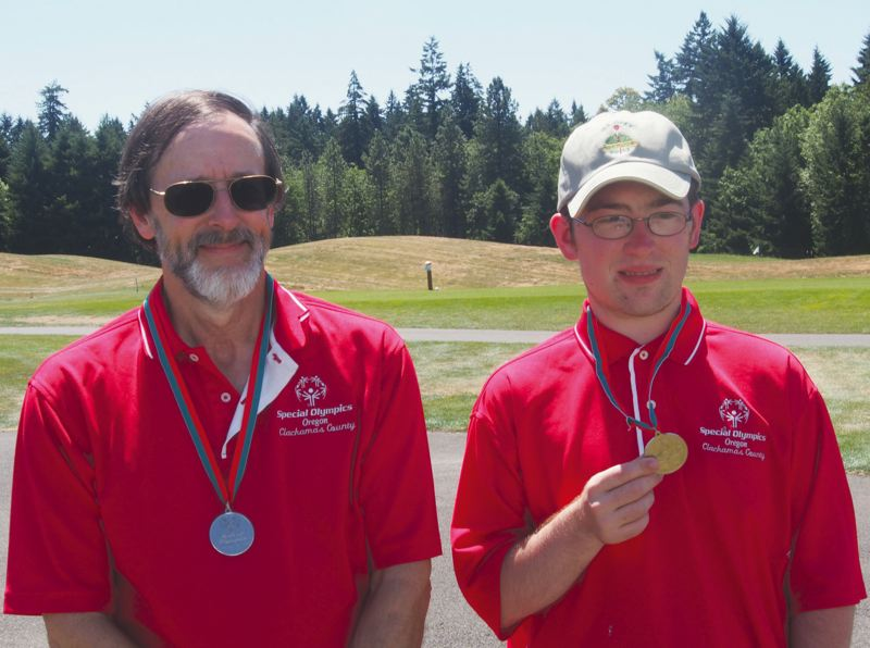 by: CONTRIBUTED PHOTO - Dale Mason and Ross Edwards combined to medal at a pair of Special Olympics alternate shot golf tournaments last month.