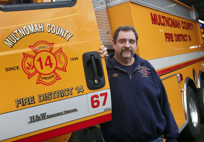 by: OUTLOOK PHOTO: JIM CLARK - Tom Layton is recognized for his efforts as a volunteer firefighter.