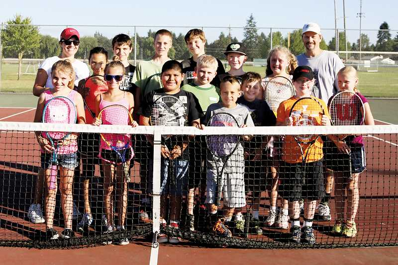 by: PHOTO BY JO WHEAT - Coach Nickie Snyder (back left) and Coach Lance Berkey (back right) lead the way with the kids at this years North Marion Tennis Camp on Wednesday.