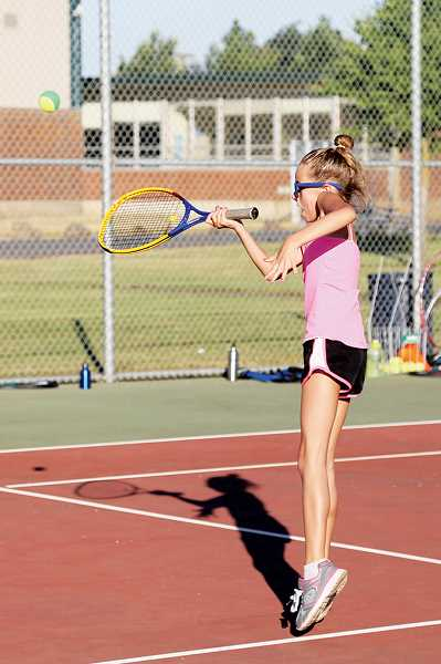 by: PHOTO BY JO WHEAT - Marissa Berkey uses a forehand shot to return the ball at Wednesdays tennis camp at North Marion High School