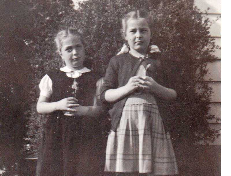 by: COURTESY OF JAN LAW AND ALICE FUREY - SOUL SISTERS - Alice (left) and Jan Boegli in their pigtails pose in the front yard of their Metzger home.