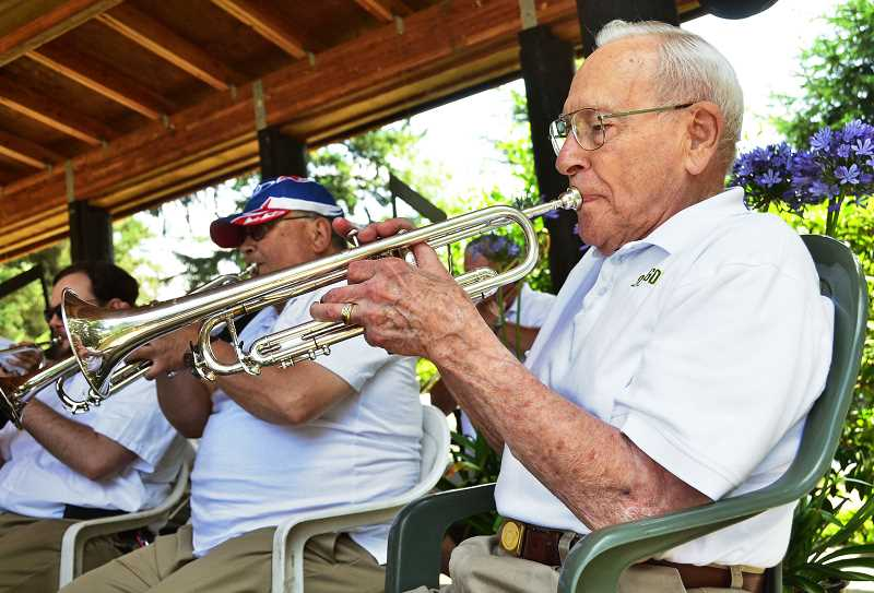 by: VERN UYETAKE - Bob Lenneville and the rest of the Clackamas Community Band perform some classic tunes Saturday at the Old Time Fair.