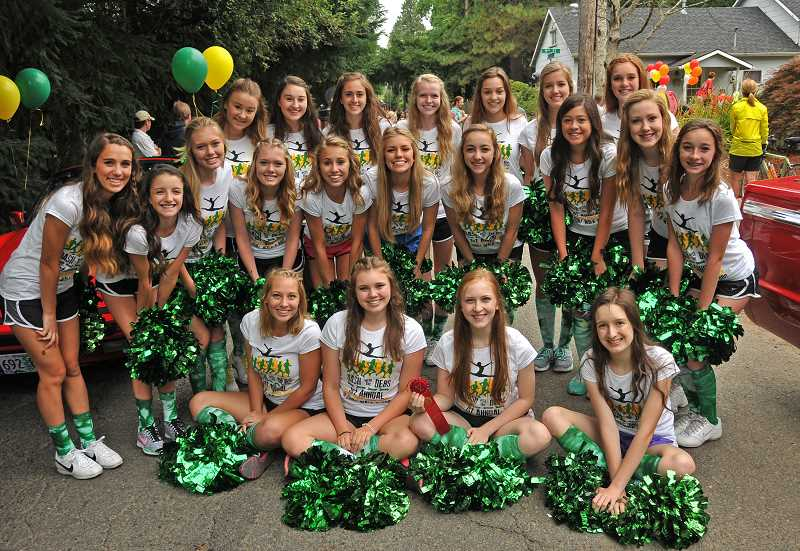 by: VERN UYETAKE - The West Linn High School Debs dance team participated during the Old Time Fair parade.