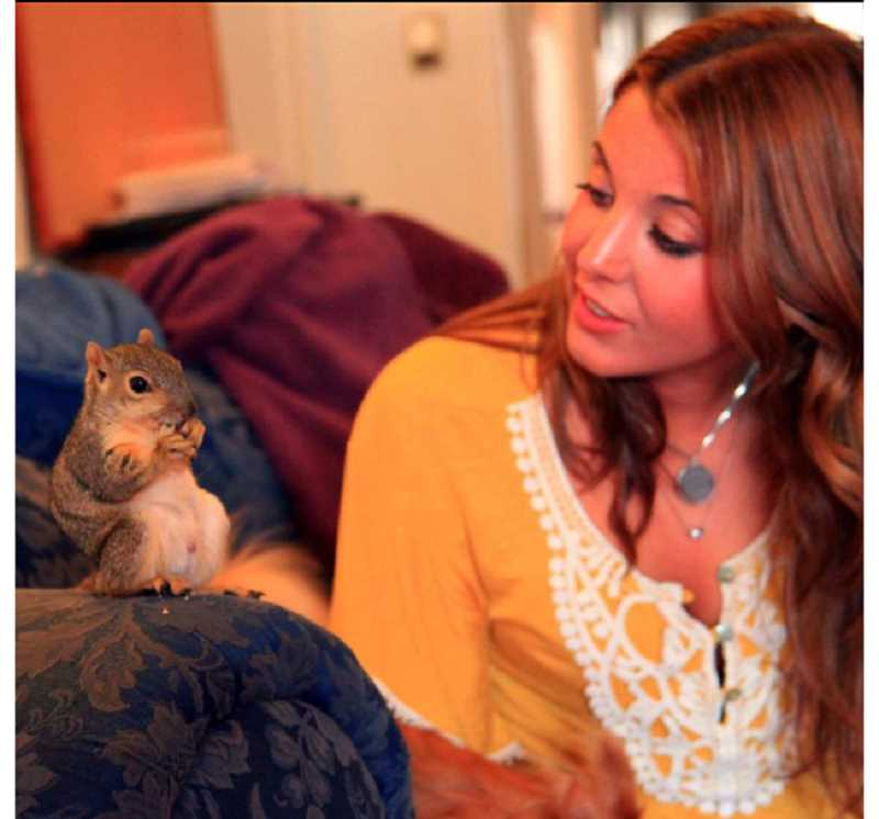 by: SUBMITTED - Kate Kelly interacts with a telegenic squirrel.
