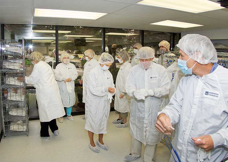 by: SUBMITTED - Patients on Patient Day put on safety apparel to tour the manufacturing plant in Lake Oswego.