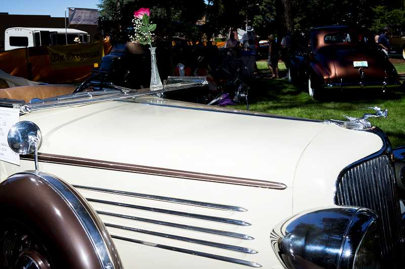 by: NEWS-TIMES PHOTOS: CHASE ALLGOOD - A rosebud sits atop a 1934 Chrysler CB owned by Hillsboro resident Lois Hanberg at the 41st Concours dElegance car show in Forest Grove, held July 21 at Pacific University.