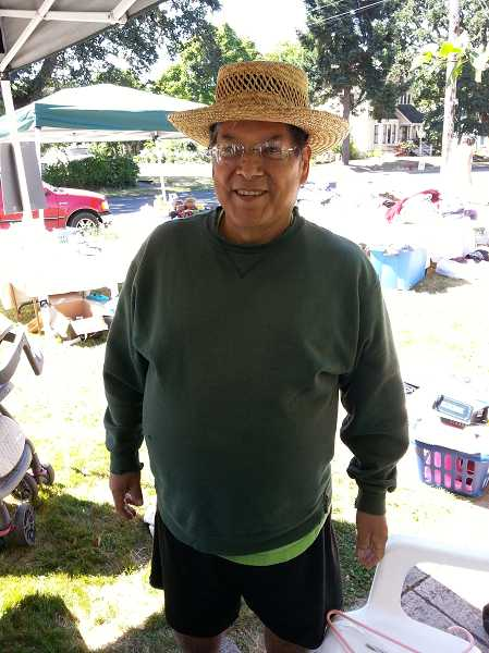 by: COURTESY PHOTO - Homer Betancourt stopped by the garage sale organized in his honor last Saturday, July  20. Treatments have helped reduce the symptoms of his bile duct cancer, and he's even been able to work a few hours a day at his Forest Grove business.