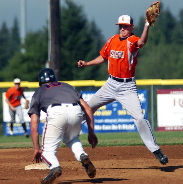 by: TIMES PHOTO: DAN BROOD - Beaverton shortstop Calvin Kelsch goes up to get the ball while Tualatins Brandon Shroyer heads to the base.