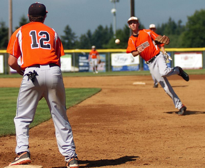 by: TIMES PHOTO: DAN BROOD - Beaverton second baseman Rob Lavey (right) flips the ball to first baseman Josh Hill.