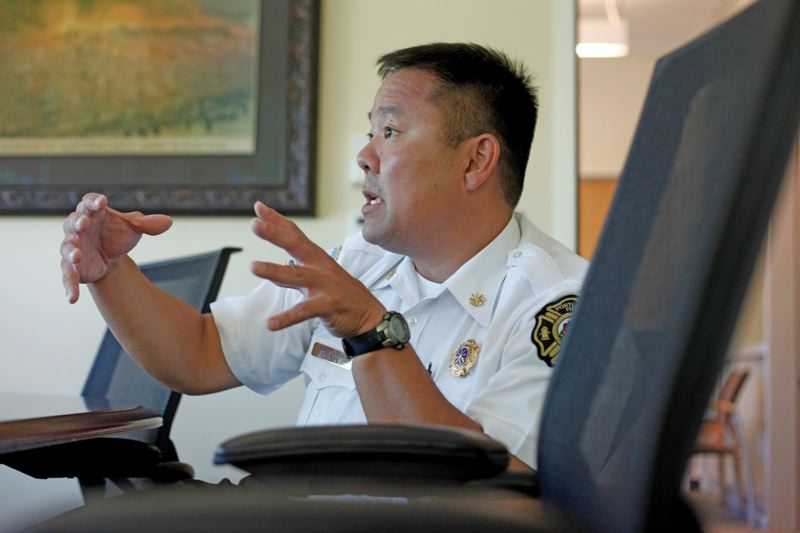 by: TRIBUNE PHOTO: JONATHAN HOUSE - Portland Fire Marshal Nate Takara has been tasked with drawing up a resolution that can gain City Council approval and pacify nightclub owners likely to object to the cost of installing sprinklers