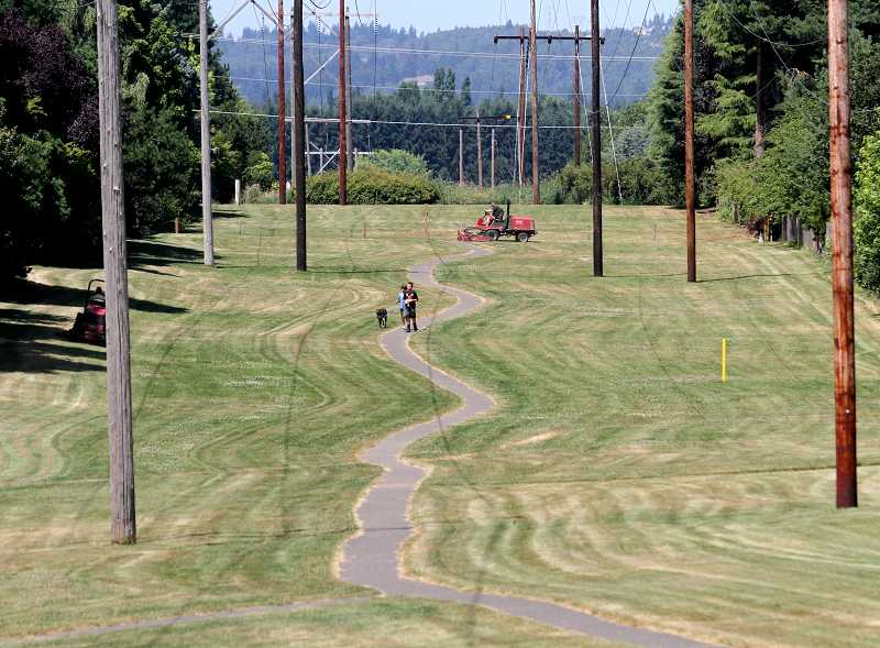 by: TIMES PHOTO: JONATHAN HOUSE - Pathways and trails dot the landscape of the Oak Hills neighborhood.