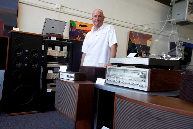by: TIMES PHOTO: JONATHAN HOUSE - InvestmentAudio co-owner Richard Hayes stands amongst the analog eqiupment that fills his store. He prefers the warmer tones that pre-digital audio equipment conveys, versus the colder and crisper modern sound from digital music players.