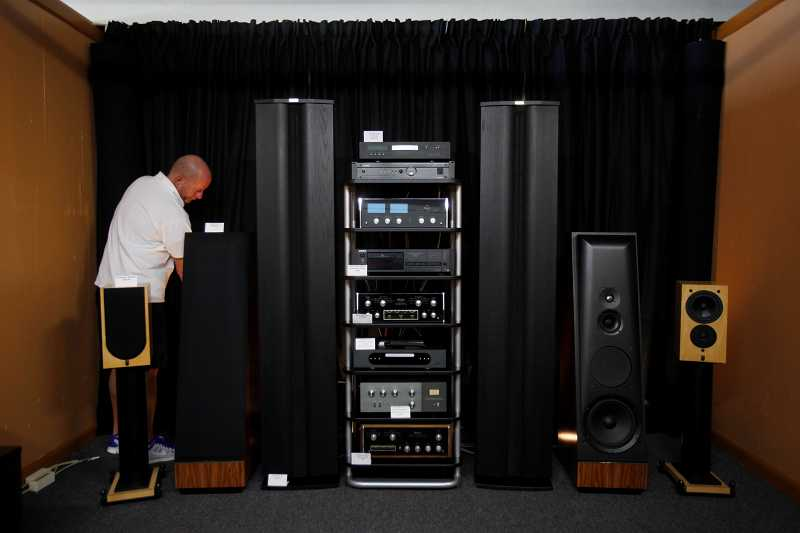 by: TIMES PHOTO: JONATHAN HOUSE - InvestmentAudio co-owner Richard Hayes sets up equipment in the store's 'Listening Room.'
