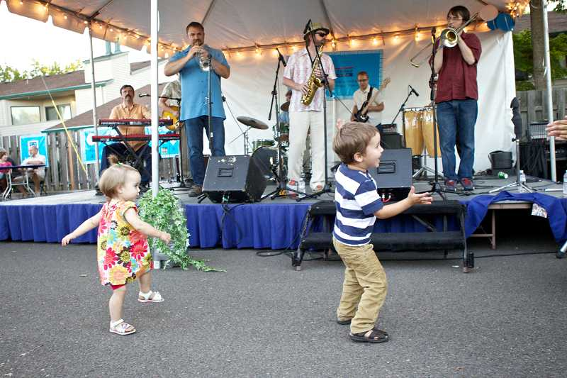 by: TIMES PHOTO: JAIME VALDEZ - Eli Wood, 16 months, and Basil Contes, 3, groove to the music during the Glendi Greek Festival.