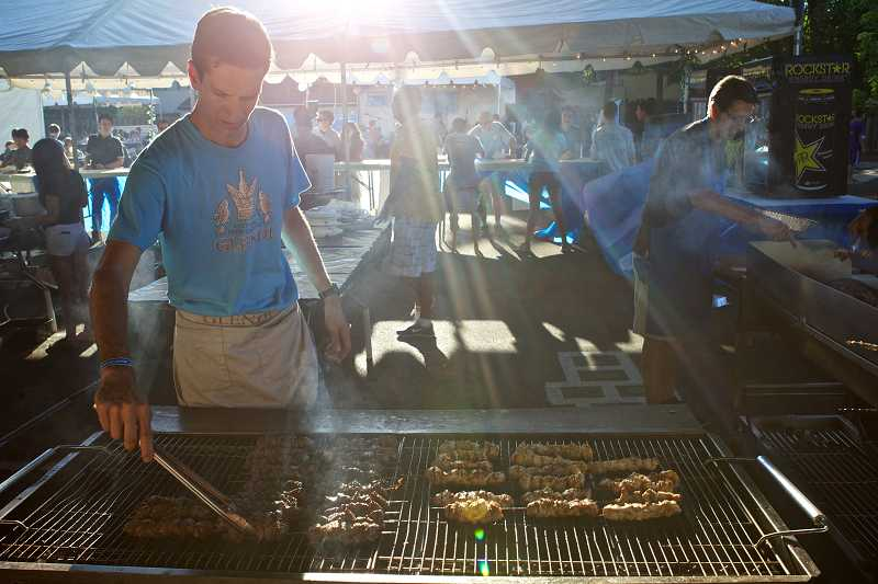 by: TIMES PHOTO: JAIME VALDEZ - Niko Poulos, who is proud to be 100 percent Greek, cooks lamb and chicken souvlaki on a grill. The festival featured a selection of specialties from Greek, Ethiopian and Middle Eastern cuisines.