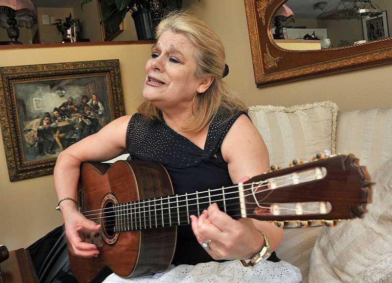 by: REVIEW PHOTO: VERN UYETAKE - Connie Bieberach is a local musician who teaches Spanish.