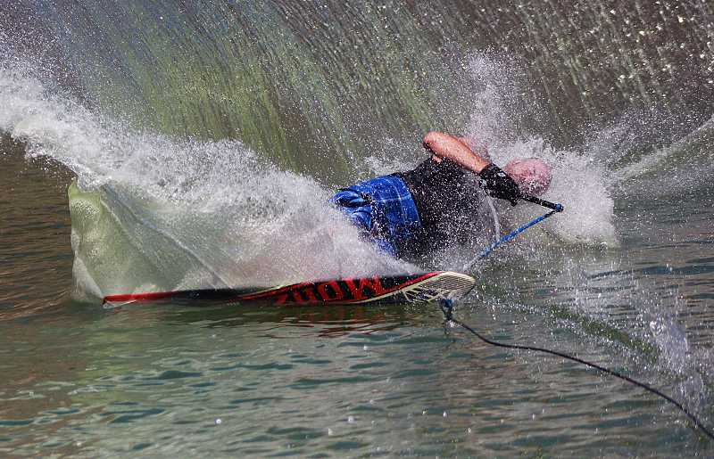 by: BILLY GATES/THE PIONEER - Blain Florence wipes out trying to make a turn during the Sundance Watersports Ski and Wakeboard Tournament on Sunday at Lake Billy Chinook outside Culver.