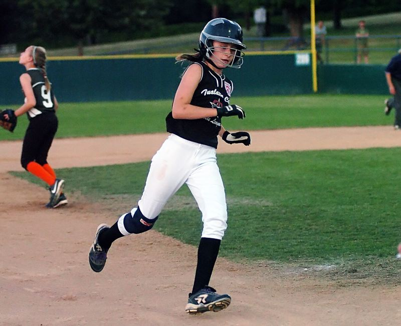 by: DAN BROOD - SPEEDY -- Samantha Teran gets ready to round third base and score in Friday's game.