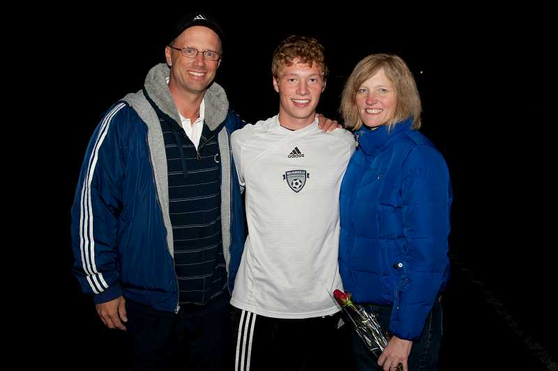 by: GREG ARTMAN - Nick Pinto (center), shown with his parents, shares a love of soccer with his family. His older sister Linnea and younger brother Collin have both played the sport, and his father Dean is an area youth coach.