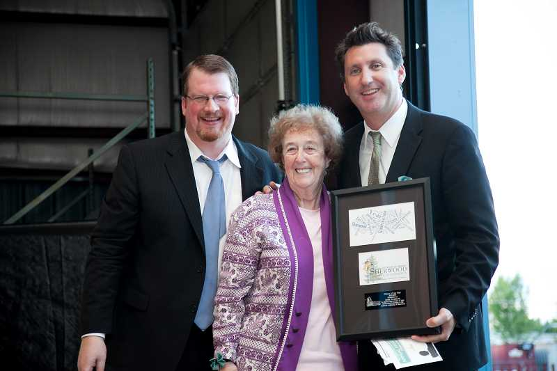 by: COURTESY OF DARCI VANDENHOEK / BLUELINE STUDIOS - TOP CITIZEN â€' Selma Broadhurst, center, receives the Sherwood Chamber of Commerce's Citizen of the Year award from former Mayor Keith Mays, left, and Tim Heine, 2011-12 chamber president and Bank of Oswego's Sherwood branch vice president and senior lending officer.