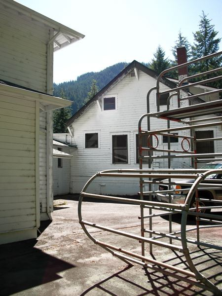 by: ISABEL GAUTSCHI - A back view of the Three Lynx school building and old playground equipment.