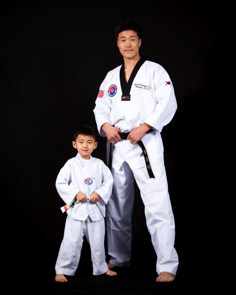 Je Kyoung Kim, standing with his son, Tyler, is a three-time world champion in taekwondo and won the gold medal in the heavyweight division at the 1992 Olympics in Barcelona where taekwondo was an exhibition sport.
