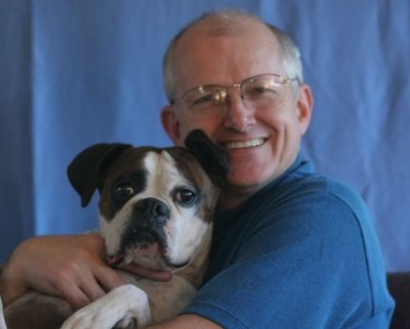 by: PHOTO COURTESY: HOLISTIC PET CENTER - Chip Sammons has a great love for dogs and cats that will be in evidence as he celebrates the 25th anniversary of his pet shop.