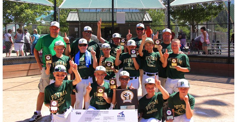 by: SUBMITTED PHOTO - There was no 11- and 12-year-old Junior American baseball team better than Putnam in 2013. The Kingsmen proved that to be the case July 12-14, when they won first place at the county championship tournament. Pictured with their championship hardware are: (first row, from left) K.J. Ruffo, Perry Collman, Nick Geertsen, John Foglio and Oscar Quick; (second row) Gavin Lund, John Irish, Korbyn Amundson, Rob Collman, Derek Douangphrachanh and Hayden Wilson; and (back) coach Mark Collman, coach Bruce Wilson, Dakota Reber, coach Jason Reber and head coach Mike Geertsen.