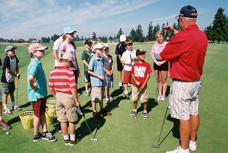 by: PHOTO BY JOHN DENNY - Stone Creek Golf Club professional Ted Westling gives instruction in putting during a summer youth camp at the Oregon City course.