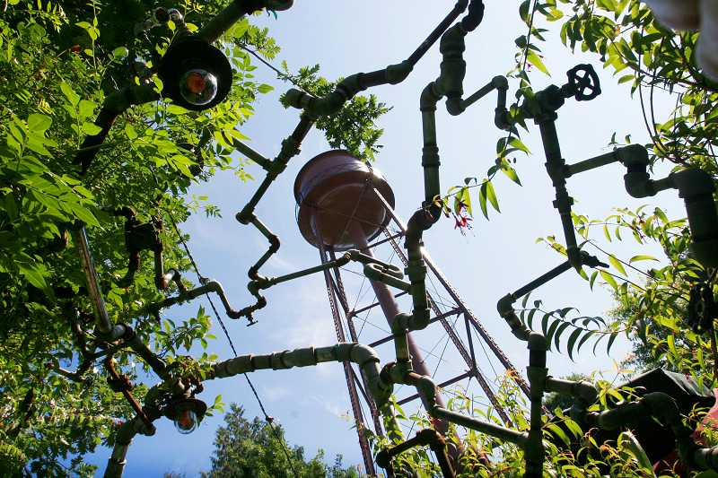 by: OUTLOOK PHOTO: JIM CLARK - This mult-fauceted sculpture draped with vines decorates the patio outside the powerhouse.