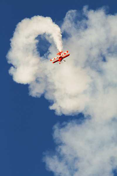 by: TIMES PHOTO: CHASE ALLGOOD - Mike Wiskus flies his Lucas Oil Pitts in the Oregon International Air Show. This 310 horsepower machine allows him to perform spins and flips to entertain the crowd.