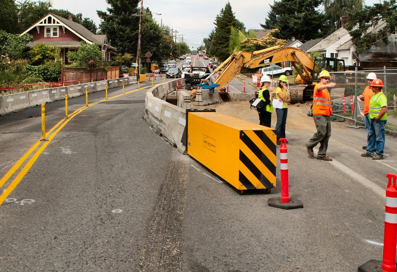 by: DAVID F. ASHTON - At S.E. 21st Avenue in Sellwood, Tacoma Street now narrows considerably to allow the Crystal Springs Creek culvert replacement project to take place across it.
