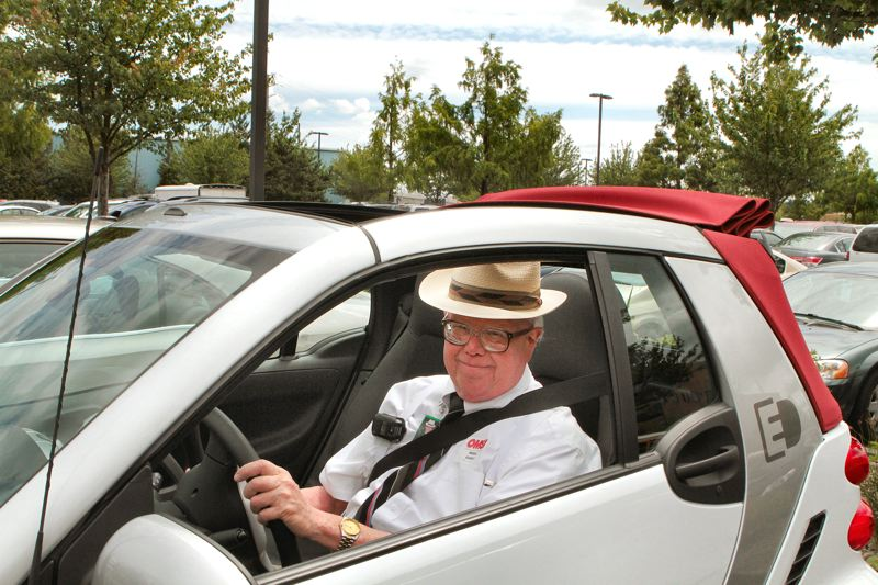 by: STAFF PHOTO - BEE correspondent David F. Ashton gets ready to take a 2013 Smart Electric Drive car test drive.