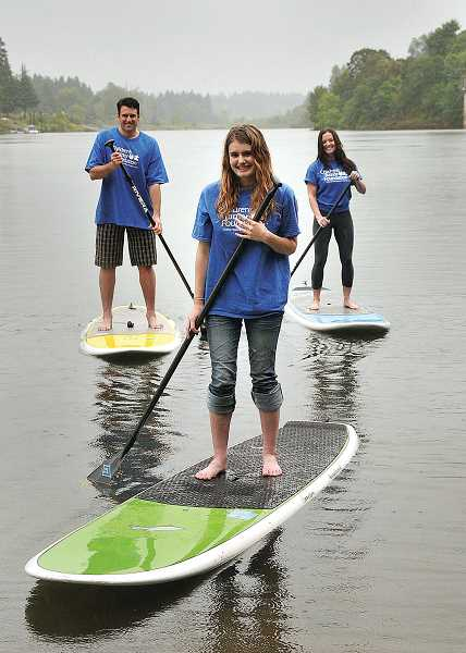 by: VERN UYETAKE - Training together for Sunday's Stand Up to NF paddleboard event are, from left,  Kevin, Hailey and Steph King.