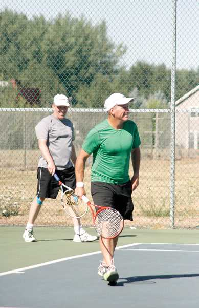by: PHIL HAWKINS - Rick Hammerquest, left, and Tom Lonergan won the Open Doubles championship at this years Woodburn Open tennis tournament. Hammerquest, of Salem, went on to win the Open Singles tournament bracket as well.