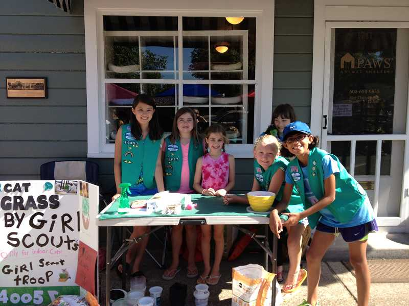 by: SUBMITTED PHOTO - The girls of Troop 40057 helped shoppers plant cat grass at the farmers market. Pictured, from left: Julia Winkle, Amanda Whittington, Katie Bell, Aislinn McCarthy, Heather MacLaren and Lyla Shukur.