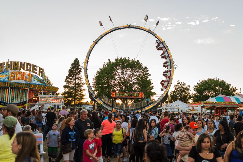 by: NEWS-TIMES PHOTO: CHASE ALLGOOD - More than 100,000 people trekked to the fairgrounds to explore rides, shows, animals and old-fashioned fair food.
